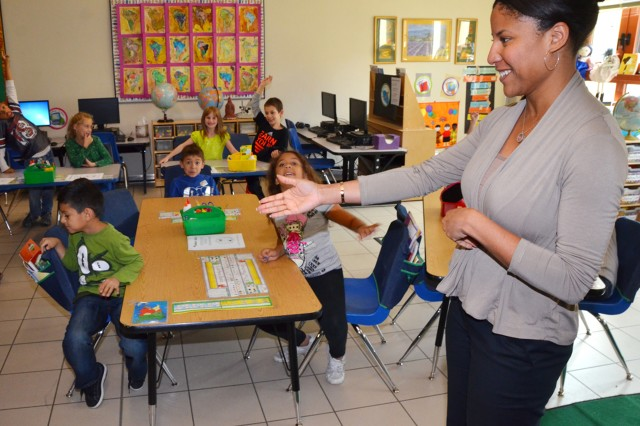 Brandy Reed, U.S. Army Garrison Vicenza Directorate of Public Works Environmental Office, calls on a student to answre a question about alternative energy sources during an Energy Awareness Month presentation at Vicenza Elementary School Oct. 21.
