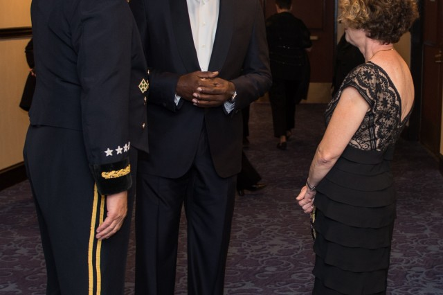 U.S. Army Chief of Staff, Gen. Raymond T. Odierno, Actor and Master of Ceremonies Dennis Haysbert, and Mrs. Linda Odierno talk before the start of the USO Annual Gala on October 25, 2013 at the Washington Hilton, Washington, D.C.(U.S. Army Photo by Sgt. Mikki L. Sprenkle/Released)