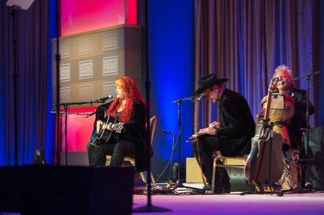 "Wynonna Judd performs a song written for the upcoming movie ""Hornets Nest""  at the 2013 USO Gala on October 25, 2013 at the Washington Hilton, Washington, D.C. (U.S. Army Photo by Sgt. Mikki L. Sprenkle/Released)"