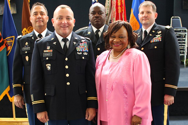 Five of the retirees honored Oct. 25 at Fort Rucker's quarterly retirement ceremony: (back) Chaplain (Maj.) Rory Rodriquez, Sgt. 1st Class Rodney Lewis, CW3 Clay Lovitt, (front) Lt. Col. Michael R. Pouncey and Allie M. Reddick.