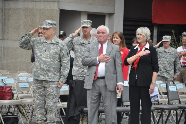 McLeese and his wife, Sue, pay their respects during the national anthem during last year's Veterans Day parade.