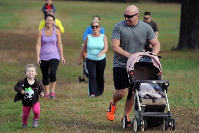More than 50 runners and walkers of all ages participated in the annual Halloween 5-kilometer Run and Walk on Oct. 31 including two-year old Addison Kennedy (left) and her dad, Fort A.P. Hill firefighter Roger (right).