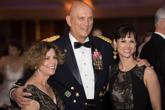 Mrs. Linda Odierno, U.S. Army Chief of Staff, Gen. Ray Odierno pose for pictures with guest during the 2013 USO Gala on October 25, 2013 at the Washington Hilton, Washington, D.C.