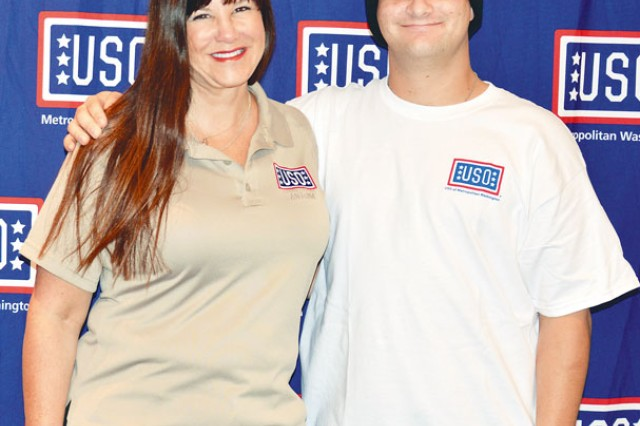 "Award winning author, Kathleen Antrim, left, takes a photo with Spc. Alex Brandt, 56th Signal Company, 54th Signal Battalion, 160th Signal Brigade, during the USO ""Operation Thriller"" tour at Fort Belvoir's USO Warrior and Family Center, Oct 24."