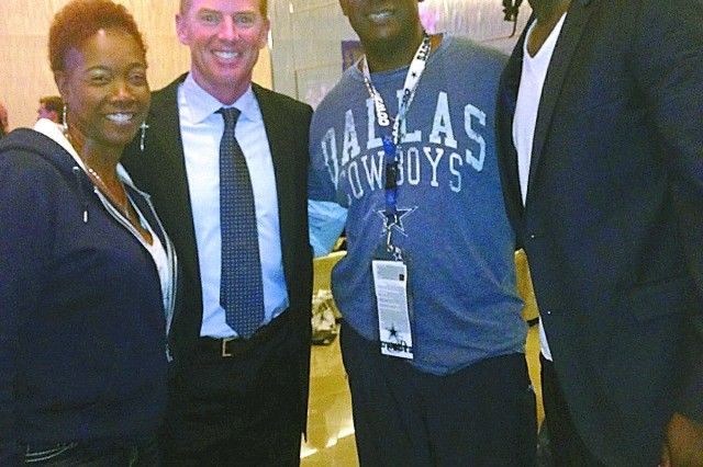 Rayford, top right, poses for a photo with his parents, Donna and Calvin Rayford, and Dallas Cowboys coach Jason Garrett.