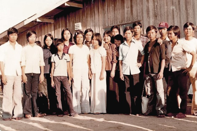 Thulan Phan (ninth from left) was the only one in her family that escaped capture and who eventually made it to America.