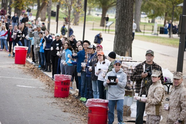 Spectators line the street to watch and cheer runners during the Marine Corps Marathon Oct. 27, 2013.