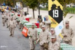 38th Marine Corps Marathon flanked by supporters