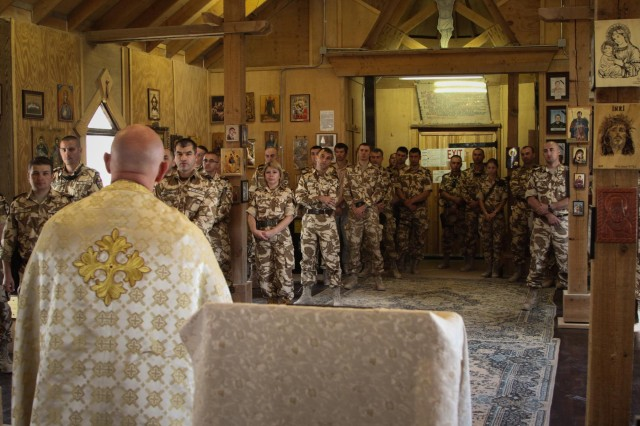 Maj. Ruston Hill, command chaplain for Combined Joint Special Operations Task Force - Afghanistan, delivers a sermon to Romanian soldiers worshiping at St. Gheorghe Chapel on Kandahar Airfield, Afghanistan, Oct. 13, 2013. (U.S. Army photo by Cpl. Mariah Best)