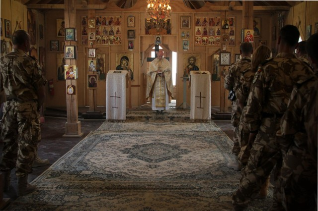 Maj. Ruston Hill, command chaplain for Combined Joint Special Operations Task Force - Afghanistan, conducts the holy liturgy at St. Gheorghe Chapel on Kandahar Airfield, Afghanistan, Oct. 13, 2013. (U.S. Army photo by Cpl. Mariah Best)