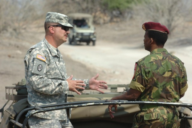 North Carolina state Senior Enlisted Adviser Command Sgt. Maj. John Swart talks with a Botswana Defence Force soldier in a recent visit Swart made during a State Partnership Program engagement in the southern Africa country. The North Carolina National Guard conducted nearly twice as many State Partnership Program engagements in 2013. As mobilizations overseas continue to trend downward, the North Carolina Guard continues to examine ways in which they can continue to sustain their current readiness and training proficiencies by using their State Partnership Program.