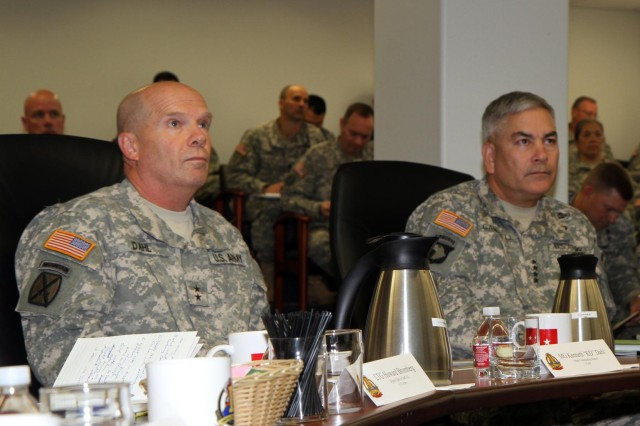 I Corps deputy commander Maj. Gen. Kenneth Dahl and Vice Chief of Staff of the Army John Campbell attend an Army Ready and Resilient Campaign implementation brief at I Corps headquarters at Joint Base Lewis-McChord, Wash., Oct 30, 2013. The senior leaders discussed the progress of Ready and Resilient Campaign programs and how to better them.
