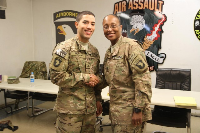 U.S. Army Sgt. Jose Rios, noncommissioned officer- in charge of human resources, Headquarters and Headquarters Battalion, 101st Airborne Division, and a native of Caguas, Puerto Rico, is congratulated by Command Sgt. Maj. Tonika Scott-Morris, HHB 101st Airborne Division, of Florence, Ala., after being named HHB 101st Airborne Division NCO of the Year at Bagram Air Field, Oct. 30, 2013. Seven NCOs competed in the annual competition. Rios may now compete at the division level upon redeployment. Competing in a deployed environment offered unique challenges to all participants. (U.S. Army National Guard photo by Sgt. Manda Walters, 129th Mobile Public Affairs Detachment/RELEASED)