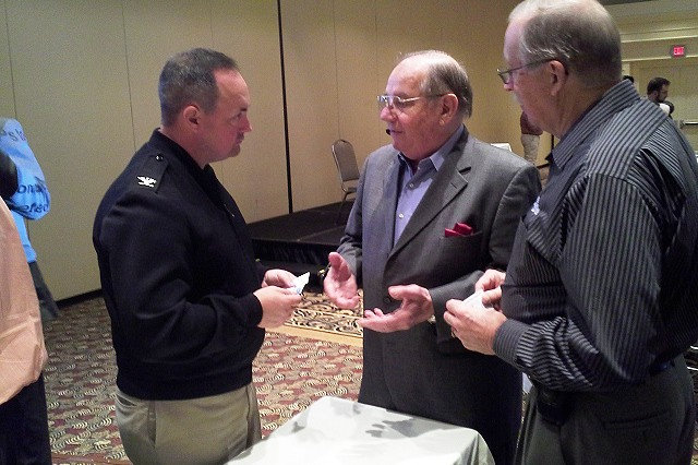 The new Personal Property Director, Navy Capt. Aaron Stanley, took opportunities during breaks to speak with various moving industry representatives who manage the movement of more than 520,000 personal property moves each year.