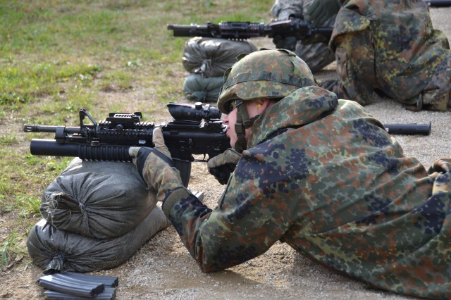 """Fifteen Soldiers from the German Bundeswehr's 4th Logistics Battalion, or the """"Elephant Battalion,"""" stationed in the Franconian city of Volkach, honed their shooting skills with Bamberg's 630th Military Police Company Oct. 29, 2013."""