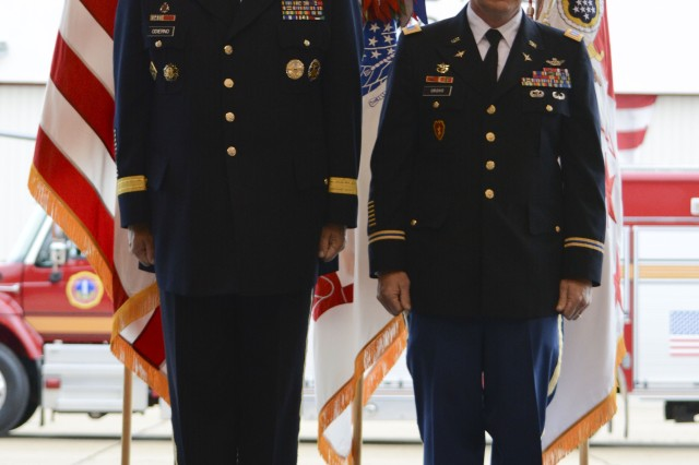 Gen. Raymond T. Ordierno, chief of Staff of the Army, and Chief Warrant Officer 4 Thomas F. Oroho, D Company commander, 12th Aviation Battalion, stand at attention during the citation reading of the Soldier's Medal presentation at Stone Hangar, Davison Army Air Field, Fort Belvoir, Va., Nov. 1, 2013.
