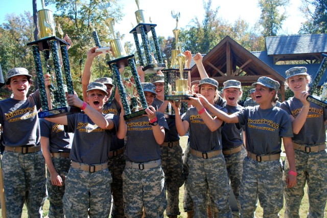 "MOLENA, Ga. "" JROTC Cadets from Adairsville (Ga.) High School, celebrate their first place victory in the overall female division at the U.S. Army National Raider Challenge Championships, here, Nov. 3."