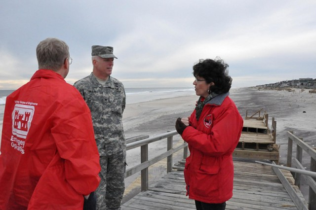 Col. Paul E. Owen, commander of the New York District of the U.S. Army Corps of Engineers and Corps personnel discuss the impacts of Hurricane Sandy to the coastline and the dunes at Westhampton Beach in Long Island while seeing the area Nov. 16, 2012. The dunes were severely impacted, but performed as designed, helping mitigate impacts to the nearby community. (Photo by Chris Gardner)