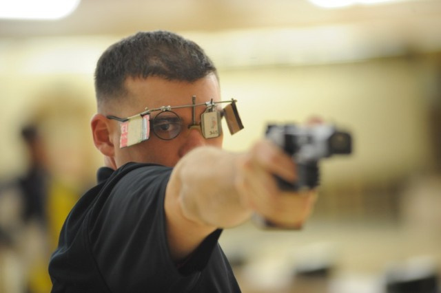 Sgt. 1st Class Keith Sanderson, infantryman, 4960th Multi-Function Training Brigade, 9th Mission Support Command, practices his pistol marksmanship.