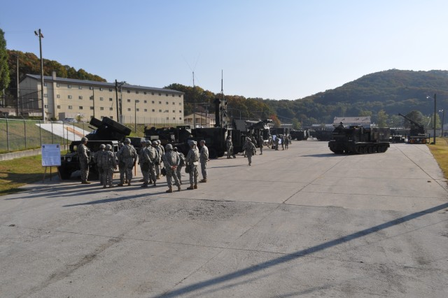 """Lt. Gen. Bernard Champoux, the Eighth Army commanding general, visits 210th Fires Brigade, 2nd Infantry Division Oct. 25, 2013 on Camp Casey, South Korea. During the visit, Soldiers demonstrated Thunder Brigade's """"Fight Tonight"""" readiness to defend the Republic of Korea by displaying avenger air defense weapon system, AN/TPQ-37 firefinder radar, and multiple launch rocket system."""
