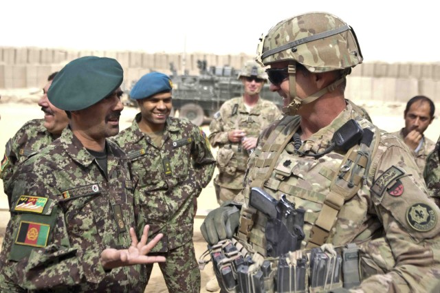 Lt. Col. Peter Zike (right), chief of Security Force Assistance Team 301, with 3rd Squadron, Combined Task Force Dragoon, speaks with Afghanistan National Army Brig. Gen. Ghulam Sarvari Murtaza (left), commander of 3rd Brigade, 205th Corps, Oct. 29, 2013, at Forward Operating Base Pasab, Afghanistan. The SFAT taught Afghan soldiers with 3rd Brigade the basics of range operations and live-fire exercise to help them improve their war fighting skills.