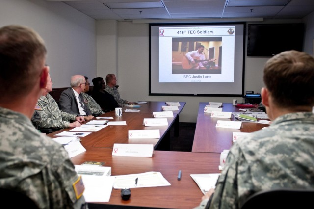 Maj. Gen. David J. Conboy (left), commander of the 416th Theater Engineer Command, and Lt. Gen. Jeffrey W. Talley, chief of Army Reserve, along with the 416th TEC senior staff, watch a music video produced by Spc. Justin Lane, an Army veteran who lost both of his legs during a deployment in Afghanistan. The video played after Talley received an operational brief on the capabilities of the 416th TEC at the Parkhurst U.S. Army Reserve Center in Darien, Ill., Nov. 1, 2013.
