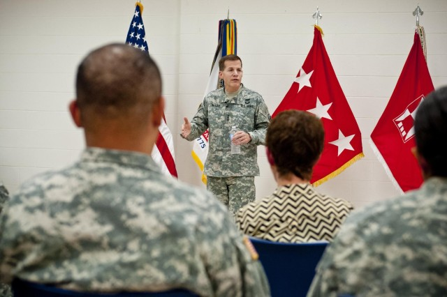 Lt. Gen. Jeffrey W. Talley, chief of Army Reserve, answers questions during a town hall meeting held with soldiers of the 416th Theater Engineer Command at the Parkhurst U.S. Army Reserve Center in Darien, Ill., Nov. 1, 2013. Approximately 60 Army civilians and Soldiers attended the meeting, from the ranks of sergeant all the way to general officer. Soldiers asked questions on a variety of topics, such as the ever-changing role of the Army Reserve in today's military, policies that would allow Reserve Soldiers to serve in a greater capacity, the recent sequestration and more. The meeting gave soldiers the opportunity to meet the chief of Army Reserve in person and receive information directly from him.