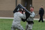 SSG Sixbury wields the baton at SPC Girst during OC Training