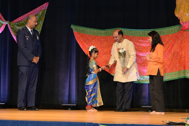 "Nine year old Nina Chaudhary, daughter of Air Force Lt. Col. Ravi Chaudhary, performed a classical dance called ""Kuchipudi"" at the Pentagon Diwali celebration. After the dance Nina presented a flower bouquet touched the feet of her teacher to take blessings. This represents the Indian culture of respecting teachers."