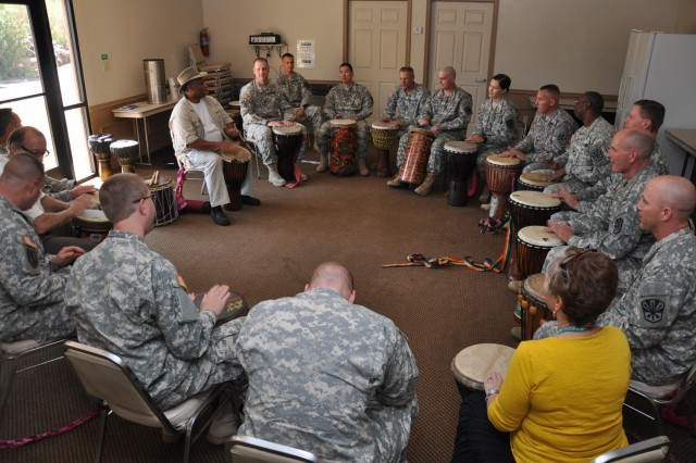 """Chaplains and chaplain assistants from the Arizona Army National Guard participate in a drumming therapy class during a recent spiritual training course at the Franciscan Renewal Center in Scottsdale, Ariz. The event helped the spiritual leaders """"re-energize,""""  so they can re-engage with their duties as chaplains and chaplain's assistants, and to get to know all the community resources Arizona has to offer to service members, said Col. Elmon Krupnik, the state chaplain."""
