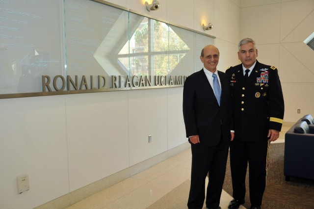 Vice Chief of Staff of the Army Gen. John Campbell poses with Ronald Katz, founder, University of California Los Angeles, Operation Mend, during a visit to the UCLA Medical Center, Nov. 1, 2013. Campbell visited Operation Mend to gain key insight and knowledge of the groundbreaking program that provides wounded military personnel with specialized care.
