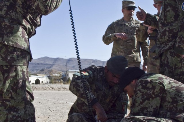 Afghan National Army soldiers with the Signal Khandak, 203rd Corps, attempt a radio transmission after setting up an OE-254 VHF antenna during their Signal Olympics, held Oct. 27, 2013, at Forward Operating Base Thunder, Afghanistan.