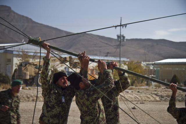 Afghan National Army soldiers with the Signal Khandak, 203rd Corps, construct an OE-254 VHF antenna during their Signal Olympics, held Oct. 27, 2013, at Forward Operating Base Thunder, Afghanistan.