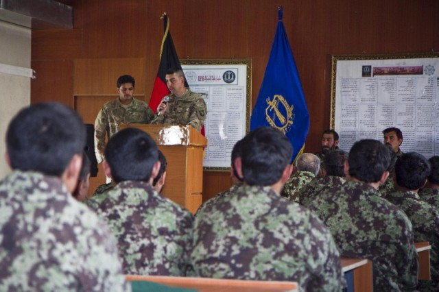 First Lt. Jack Stefchek, adviser to the Afghan National Army's 203rd Corps, Signal Khandak, and signal officer with the 4th Brigade Combat Team, 101st Airborne Division (Air Assault), gives a speech Oct. 30, 2013, during an awards ceremony for the Signal Olympics, at Forward Operating Base Thunder, Afghanistan.