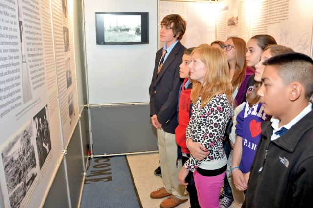 Wiesbaden Middle School students browse through the displays of the John F. Kennedy in Hessen exhibition, on display at the school. The traveling exhibit, compiled by members of the Hessen State Archive, continues through Nov. 24.