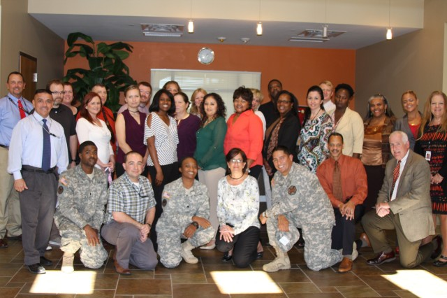 "New U.S. Army Installation Management Command headquarters employees attending Newcomers Orientation, an IMCOM pilot program held at Joint Base San Antonio "" Fort Sam Houston, pose for a snapshot between training blocks."