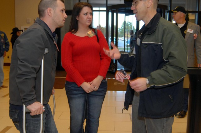 Wounded hero Spc. Chad Traffansted, left, and his wife Ashley, from Fort Payne, receive a warm welcome to the 2012 Heroes Week from volunteer Paul Sullivan. Heroes Week kicks off today, as wounded service members from across the country arrive in Huntsville.