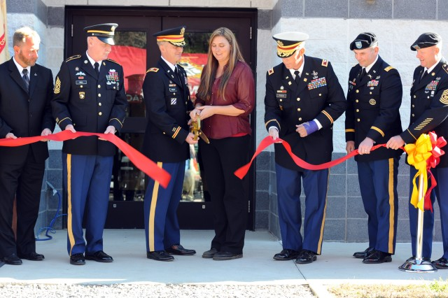The Explosive Ordnance Disposal Training Center at Fort A.P. Hill, Va. was renamed today in honor of Capt. Jason T. McMahon, an EOD Soldier who died in action in Afghanistan. Shown here cutting the ribbon from left to right are: Marcus E. Markham, Director, Munitions and EOD Training Department,  Command Sgt. Maj. Clinton G. Hall, the Ordnance Regimental Command Sergeant Major, Col. Jack Haley, the Army's 38th Chief of Ordnance and Commandant of the U.S. Army Ordnance School, Fort Lee, Va., Jennifer McMahon, widow of Capt. Jason T. McMahon, Col. Mark A. Fitch, Chief, Explosive Ordnance Disposal Directorate, Lt. Col. Peter E. Dargle, commander U.S. Army Garrison Fort A.P. Hill, Va. and Command Sgt. Maj. Keith R. Whitcomb, garrison command sergeant major.