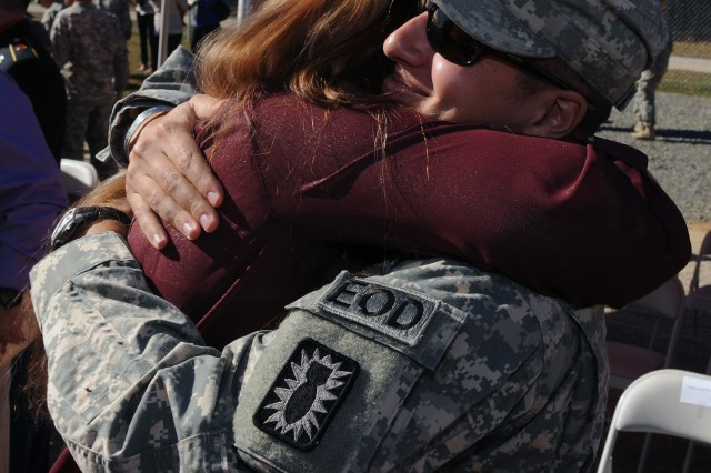 Jennifer McMahon (left) hugs Capt. Greg Abide following the Nov. 6 ribbon cutting and memorialization ceremony in honor of her husband Capt. Jason T. McMahon. Abide served as one of Jason McMahon's platoon leaders in Afghanistan in 2010. McMahon died after being critically wounded during combat with enemy insurgents in Laghman Province, Afghanistan.