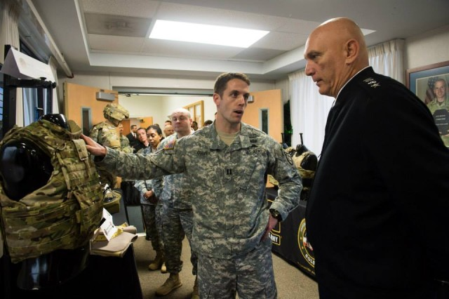 An Officer from the Program Executive Office (PEO) Soldier team briefs U.S. Army Chief of Staff Gen. Ray Odierno on the Female Improved Outer Vest during his visit to their facility at Fort Belvoir, VA, Nov 1, 2013. (U.S. Army photo by Staff Sgt. Steve Cortez/ Released)