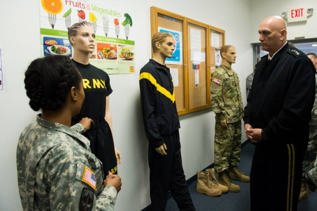 An Officer from the Program Executive Office (PEO) Soldier briefs U.S. Army Chief of Staff Gen. Ray Odierno on the new Army Physical Fitness Uniform during his visit to their facility at Fort Belvoir, VA, Nov 1, 2013. (U.S. Army photo by Staff Sgt. Steve Cortez/ Released)