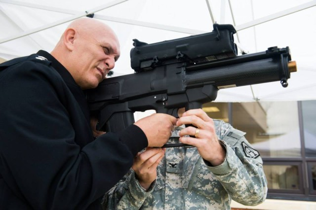 U.S. Army Chief of Staff Gen. Ray Odierno looks through the sight of an XM25 Counter Defilade Target Engagement System during his visit to the Program Executive Office (PEO) Soldier facility at Fort Belvoir, VA, Nov 1, 2013. (U.S. Army photo by Staff Sgt. Steve Cortez/ Released)