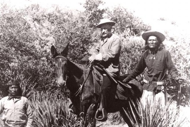 General Crook aboard his mule, White Mountain Apache Scout William Alchesay on the right, and an unknown Apache scout on the left. Taken in Apache Pass near Fort Bowie.