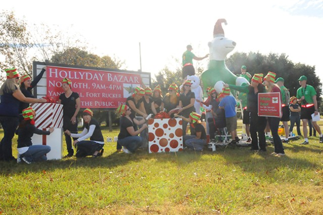 The FRCSC joins the Foxhounds, Warrant Officer Career College Class 1401, Nov. 2 as they paint Sgt. Ted E. Bear as a polar elf to advertise the annual Hollyday Bazaar, which will be held Nov. 16 from 9 a.m. to 4 p.m. at Yano Hall, Bldg. 6005 on Fort Rucker, between the Lemon Lot and the U.S. Army Aviation Museum on Andrews Avenue.