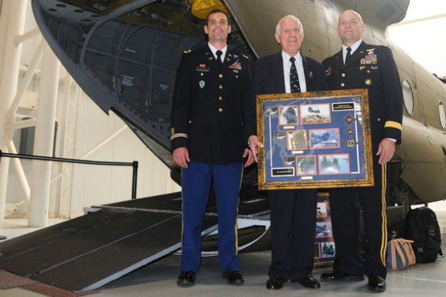 WO1 Ryan Thurgood, B Company, 2nd Aviation Regiment, 149th General Support Aviation Battalion from Grand Prairie, Texas, stands with his grandfather, retired Lt. Col. Leon Thurgood, and his uncle, Brig. Gen. Neil Thurgood, Program Executive Officer, Missiles and Space, Redstone Arsenal, during his graduation ceremony Oct. 31 at the U.S. Army Aviation Museum.
