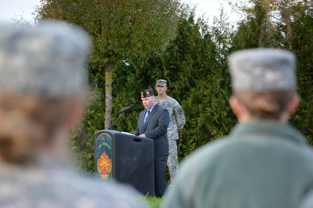 Master Sgt. Christopher Buchanan delivers the keynote speech at the U.S. Army Garrison Ansbach Veterans Day ceremony Nov. 7 at Memorial Garden next to 12th Combat Aviation Brigade headquarters.