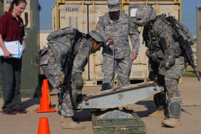 Jan Redmond (left), a research scientist with U.S. Army Medical Command's U.S. Army Research Institute of Environmental Medicine, observes a timed test as Soldiers assigned to the 1st Brigade Combat Team, 1st Cavalry Division, construct parts of a Bailey bridge during the Army's Physical Demands Study at Fort Hood, Texas, Sept. 12, 2013.