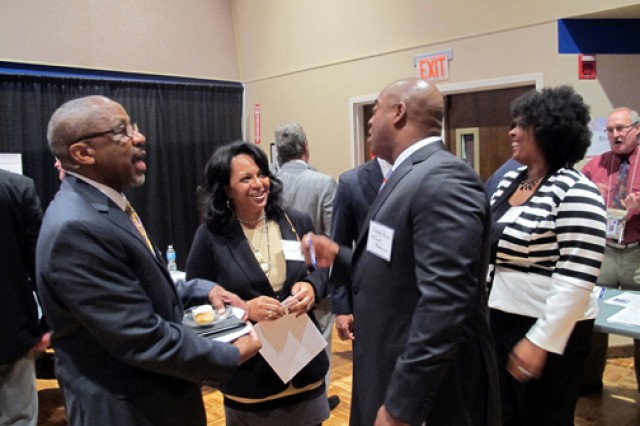 Lisa Harris, program manager, Huntsville Center's Installation Support and Programs Management Directorate, speaks with Jesse Nunn, president at Future Research Corporation of Huntsville, during the networking session at the 2013 Huntsville Center Small business Forum held Nov. 8.
