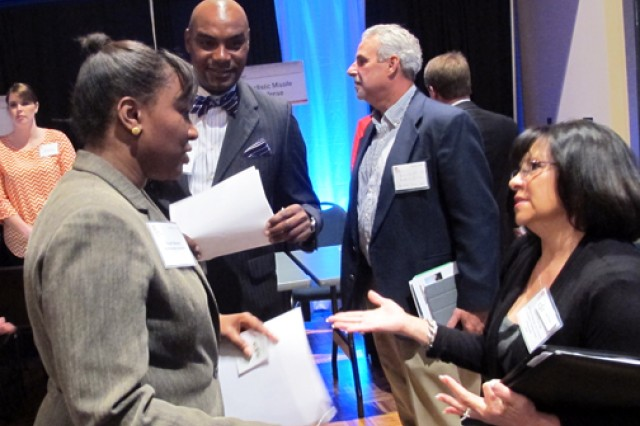 Nicole Boon, Huntsville Center's Small Business Programs specialist, speaks with contractors' during the breakout session at the 2013 Huntsville Center Small business Forum held Nov. 8.