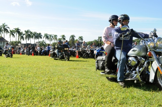 "Nearly 400 Army motorcycle riders "" Soldiers and spouses "" took part in a food drive event in Hawaii, including a 20-mile motorcycle ride to deliver the food and visit with local veterans."